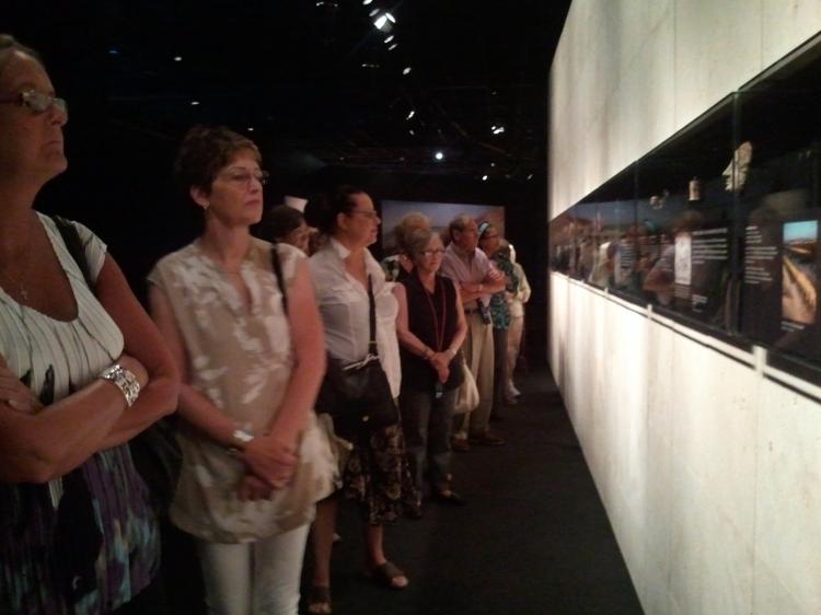 Congregation members viewing artifacts