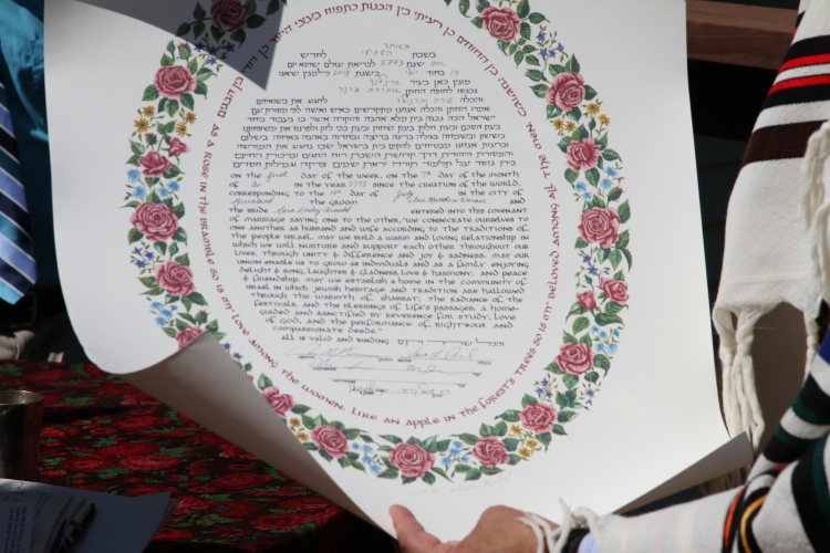 Our Ketubah: Hebrew and English text surrounded by roses