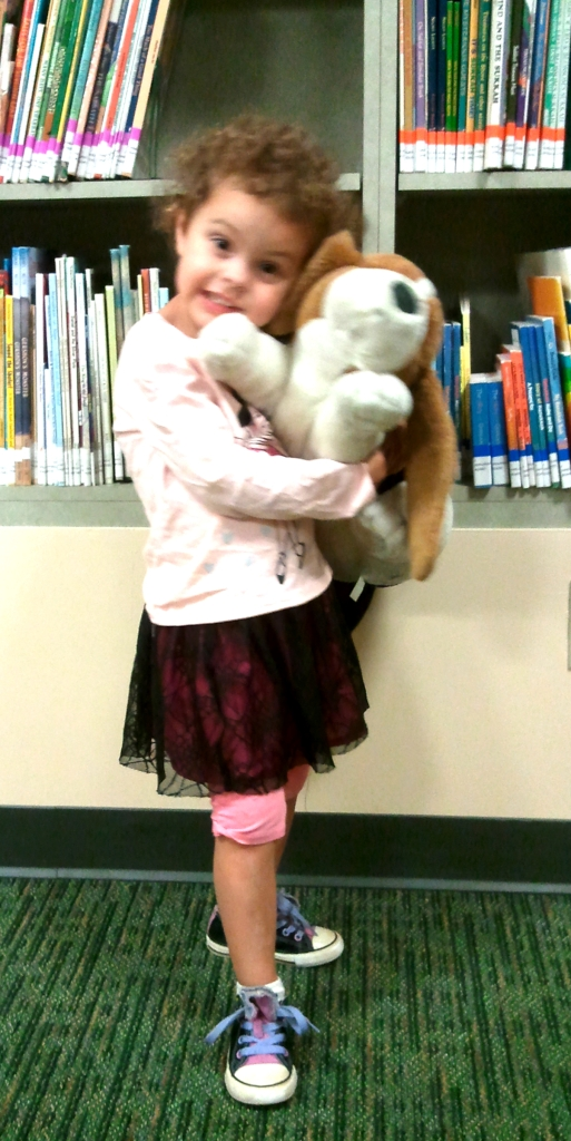 Little girl and Libby the Library Hound